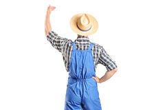 Male farmer gesturing with hand Stock Image