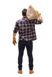 Male farmer holding a burlap sack on his shoulder Stock Image