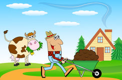 Male Farmer Pushing A Cart With Black Earth Royalty Free Stock Images