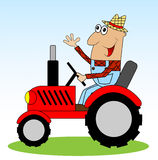 Male farmer rides a tractor Royalty Free Stock Image