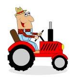 Male farmer rides a tractor Stock Photos