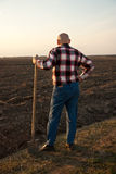 Male farmer with spade  back Royalty Free Stock Photography