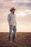 Male Farmer Standing on Fertile Agricultural Farm Land Soil Stock Photos