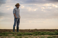 Male Farmer Standing on Fertile Agricultural Farm Land Soil Royalty Free Stock Photo