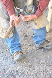 Male farrier. Male farrier working on a horseshoe on a ranch Stock Images