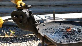 Male farrier working. Male farrier working on a horseshoe outdoors Royalty Free Stock Images