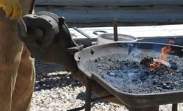 Male farrier working. Male farrier working on a horseshoe outdoors Stock Images