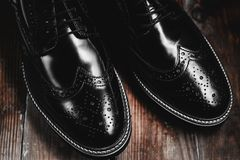 Male Fashion black shoes. In wooden background Royalty Free Stock Photography