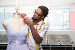 Male fashion designer and mannequin Stock Images