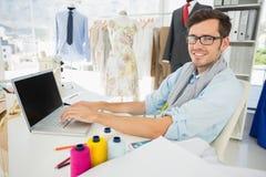 Male fashion designer using laptop Stock Photo