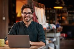 Male Fashion Designer Working At Laptop In Studio Stock Photos