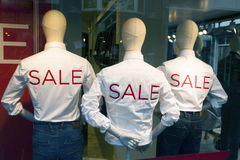 Male fashion dolls with jeans and sale printed on white shirts Royalty Free Stock Image