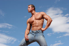Male fashion model. In blue jeans Stock Photos