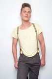 Male Fashion Model. Posing with suspenders Stock Photo