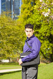Male fashion model with a bag Stock Photo