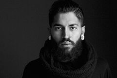 Male fashion model with beard. Black and white close up portrait male fashion model with beard and piercing Royalty Free Stock Photos