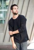 Male fashion model with beard posing outdoors Stock Photo