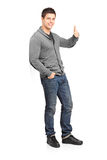 Male fashion model giving a thumb up Royalty Free Stock Photo
