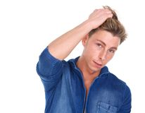 Male fashion model with hand in hair Stock Photography