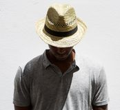 Male fashion model with hat looking down Stock Photo
