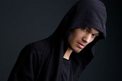 Male fashion model with hooded sweat shirt Stock Image