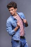 Male fashion model with modern haircut Stock Photo