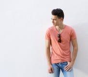 Male fashion model posing against white background. Portrait of a male fashion model posing against white background Royalty Free Stock Image
