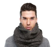 Male fashion model posing with gray wool scarf. Close up portrait of a male fashion model posing with gray wool scarf Stock Image