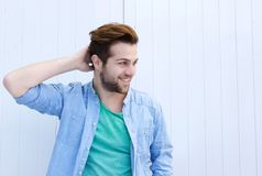 Male fashion model posing with hand in hair. Close up portrait of a male fashion model posing with hand in hair Royalty Free Stock Image