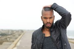 Male fashion model posing outdoors Royalty Free Stock Photo