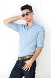 Male fashion model posing with sunglasses. Portrait of a handsome male fashion model posing with sunglasses Royalty Free Stock Images
