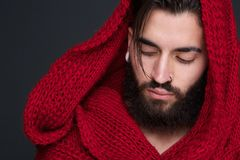 Male fashion model with red scarf. Close up portrait of a male fashion model with red scarf Royalty Free Stock Photography