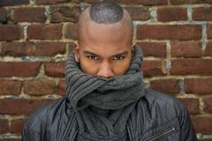 Male fashion model with scarf covering face Royalty Free Stock Image
