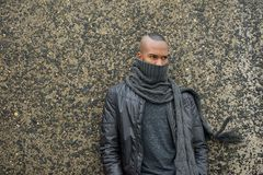 Male fashion model with scarf and leather jacket Stock Images