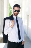 Male fashion model in shirt and tie posing outside Royalty Free Stock Photo