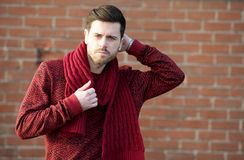 Male fashion model standing outdoors with hand in hair Stock Photography