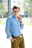 Male fashion model standing outdoors Royalty Free Stock Photography