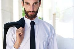 Male fashion model standing outdoors with shirt and tie. Close up portrait of a male fashion model standing outdoors with shirt and tie Stock Photo