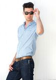 Male fashion model with sunglasses. Portrait of an attractive male fashion model with sunglasses Stock Images