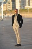 Male fashion model in trendy clothes standing outdoors Stock Image