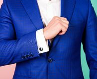 Male fashion. Shirt sleeve with cufflink instead button. Cufflinks match luxury classic suit jacket. Make sure outfit. And appearance look perfect. Detail make Stock Photography