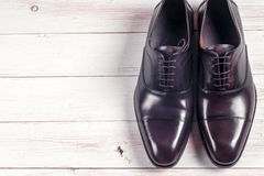 Male fashion with shoes on white. Wooden background Royalty Free Stock Photography