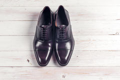 Male fashion with shoes on white. Wooden background Royalty Free Stock Image