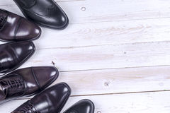 Male fashion with shoes on white. Wooden background Stock Images
