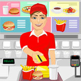 Male fast food restaurant employee returning a credit card Stock Photo