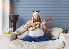Male entertaining in his apartment Stock Photo