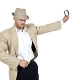 Male with fedora hat and magnifier Royalty Free Stock Photos