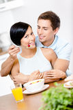 Male feeds and hugs his girlfriend Royalty Free Stock Photos