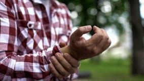 Male feeling wrist pain, carpal tunnel syndrome, osteoarthritis, inflammation. Stock photo stock image