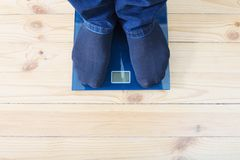 Male feet on the floor scales. The male feet on the floor scales Royalty Free Stock Photos